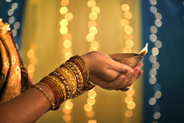 hands holding Indian oil lamp